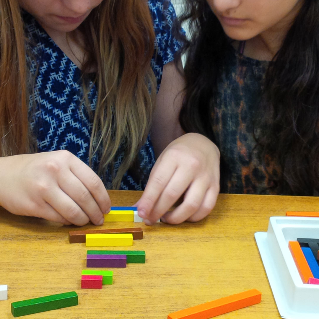 Two girls working with blocks
